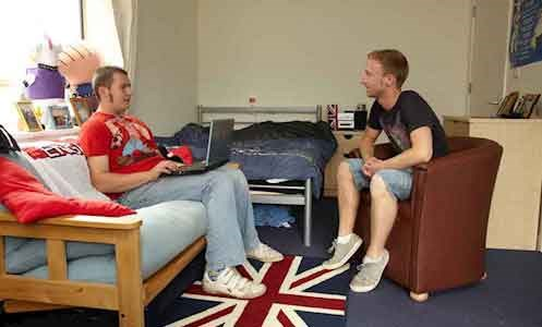 two autistic male service users sitting in a bedroom at Hamilton Lodge