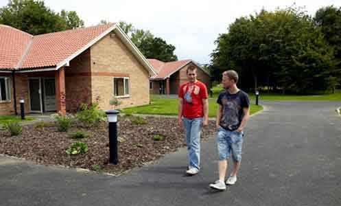 two autistic male service users walking  outside Hamilton Lodge