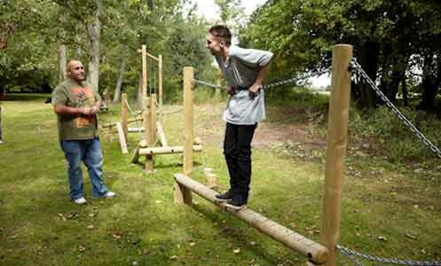 Two autistic service users outside in Hamilton Lodge's Green Gym