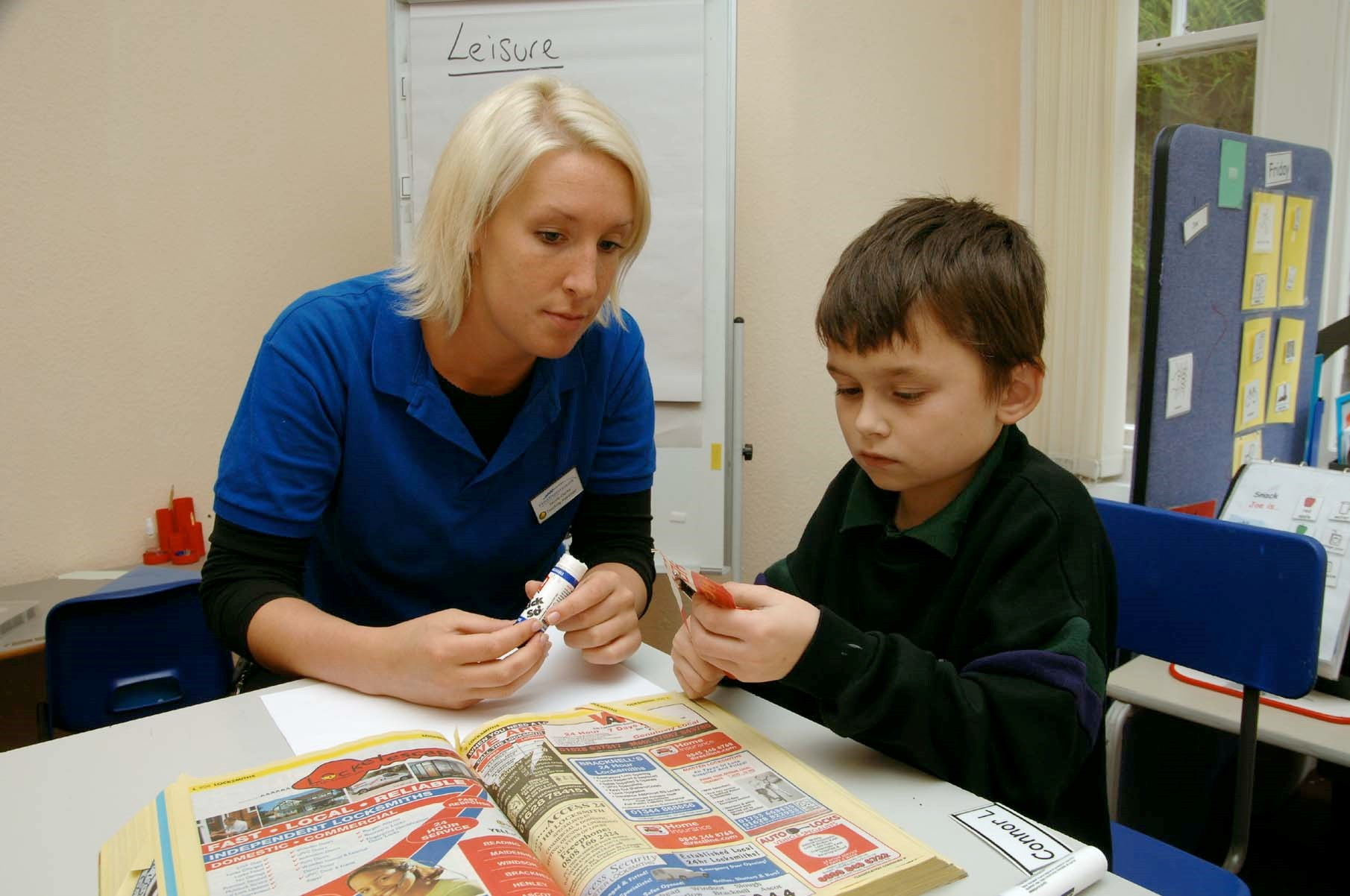 young autistic boy in lessons with female support worker in Heathermount