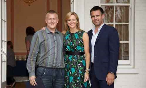 Gabby and Kenny Logan standing with Heathermount service users at certficate presentation