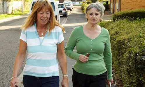 support worker walking with service user in the streets around Kent House