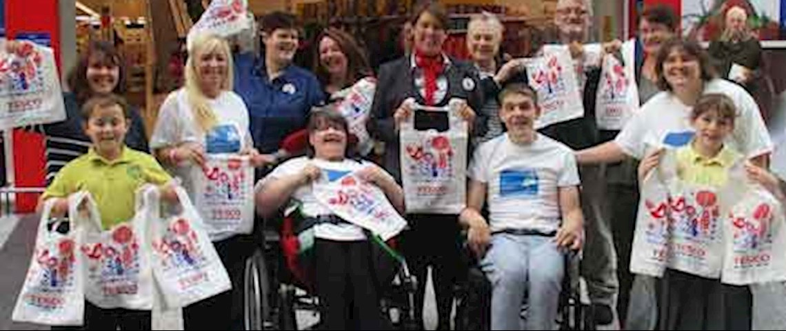staff and residents at Victoria House thank Tesco's Bags of Help scheme