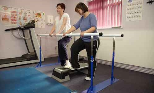 female service user in physical rehabilitation session at York House with female support worker