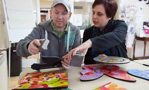 support worker in art therapy session with male service user in York House