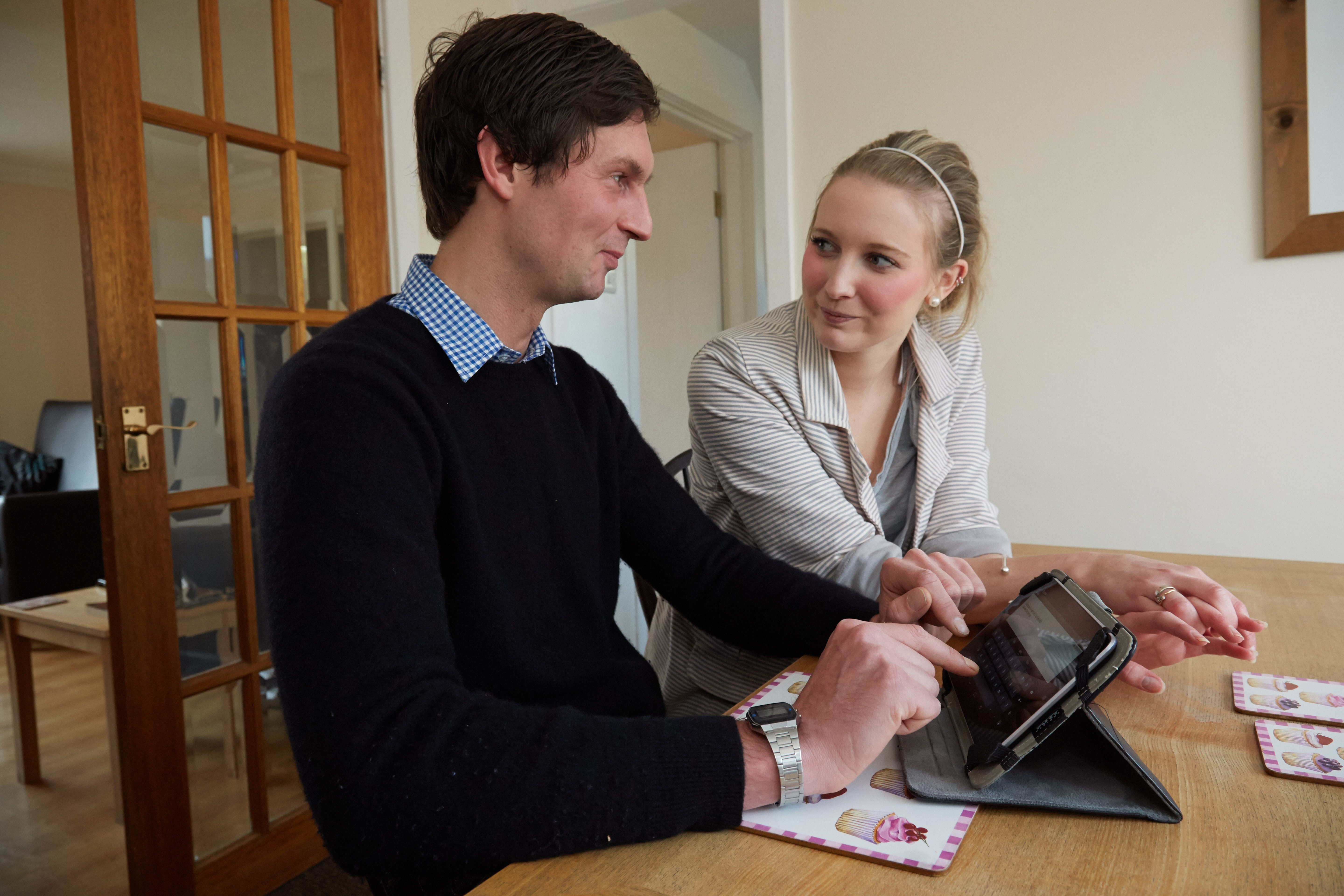 service user sitting at an i-pad with support worker at Daniel Yorath House