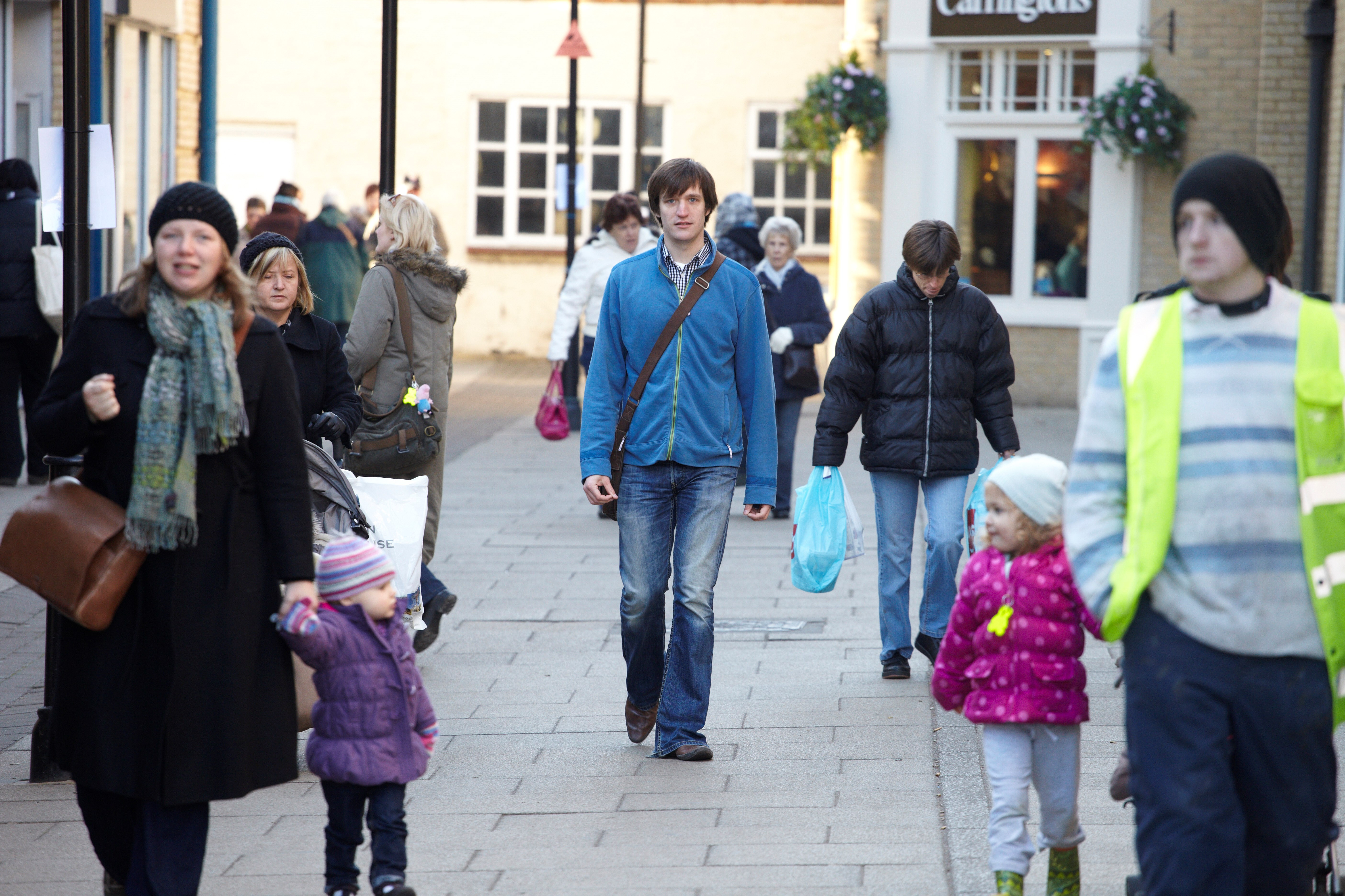 Fen House service user Luke walking in the streets of Ely