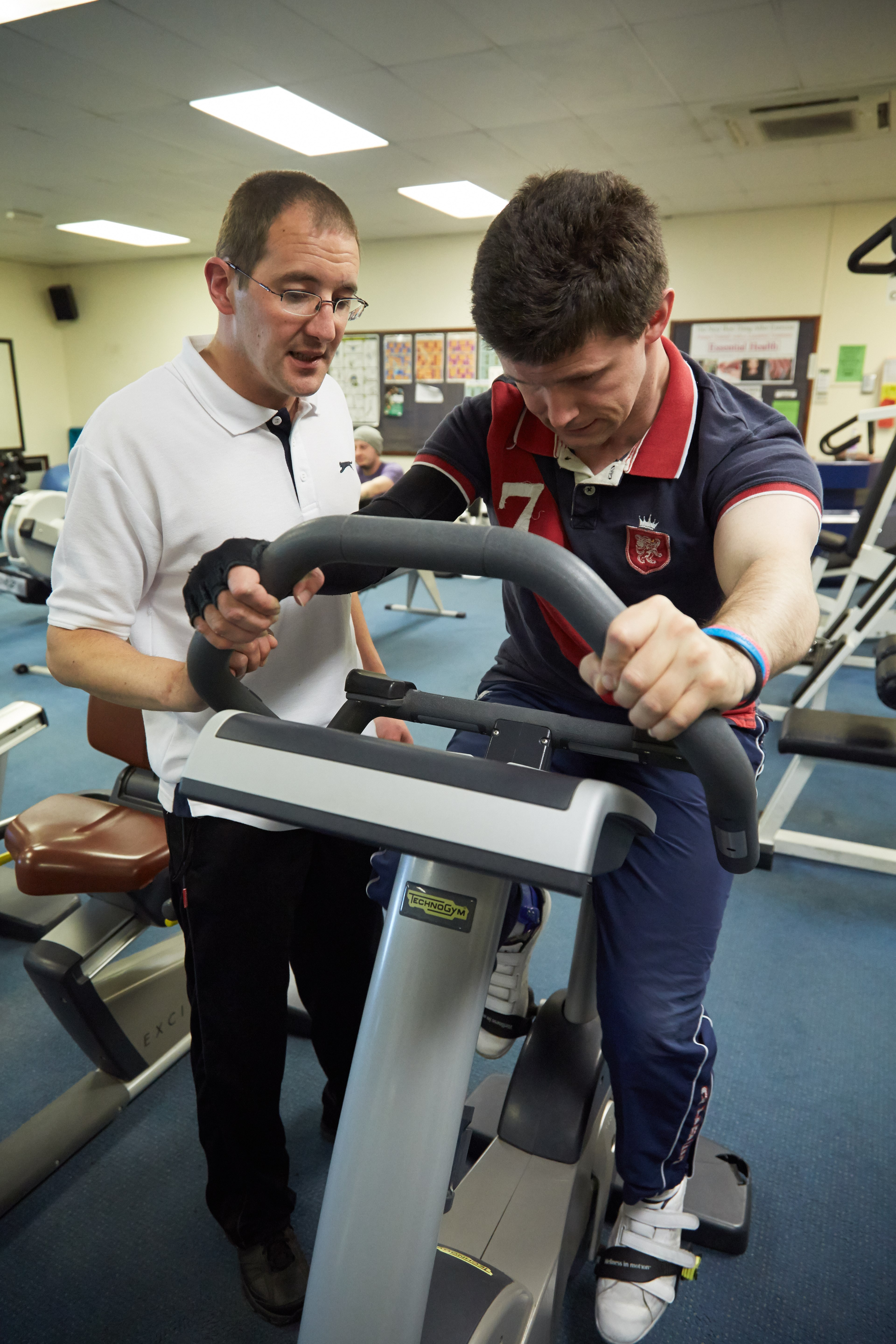 service user in physical therapy with support worker observing in Fen House