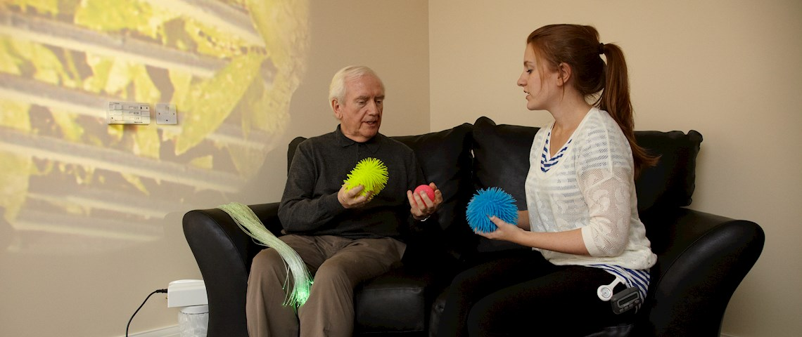 service user and support worker in the sensory room at Graham Anderson House