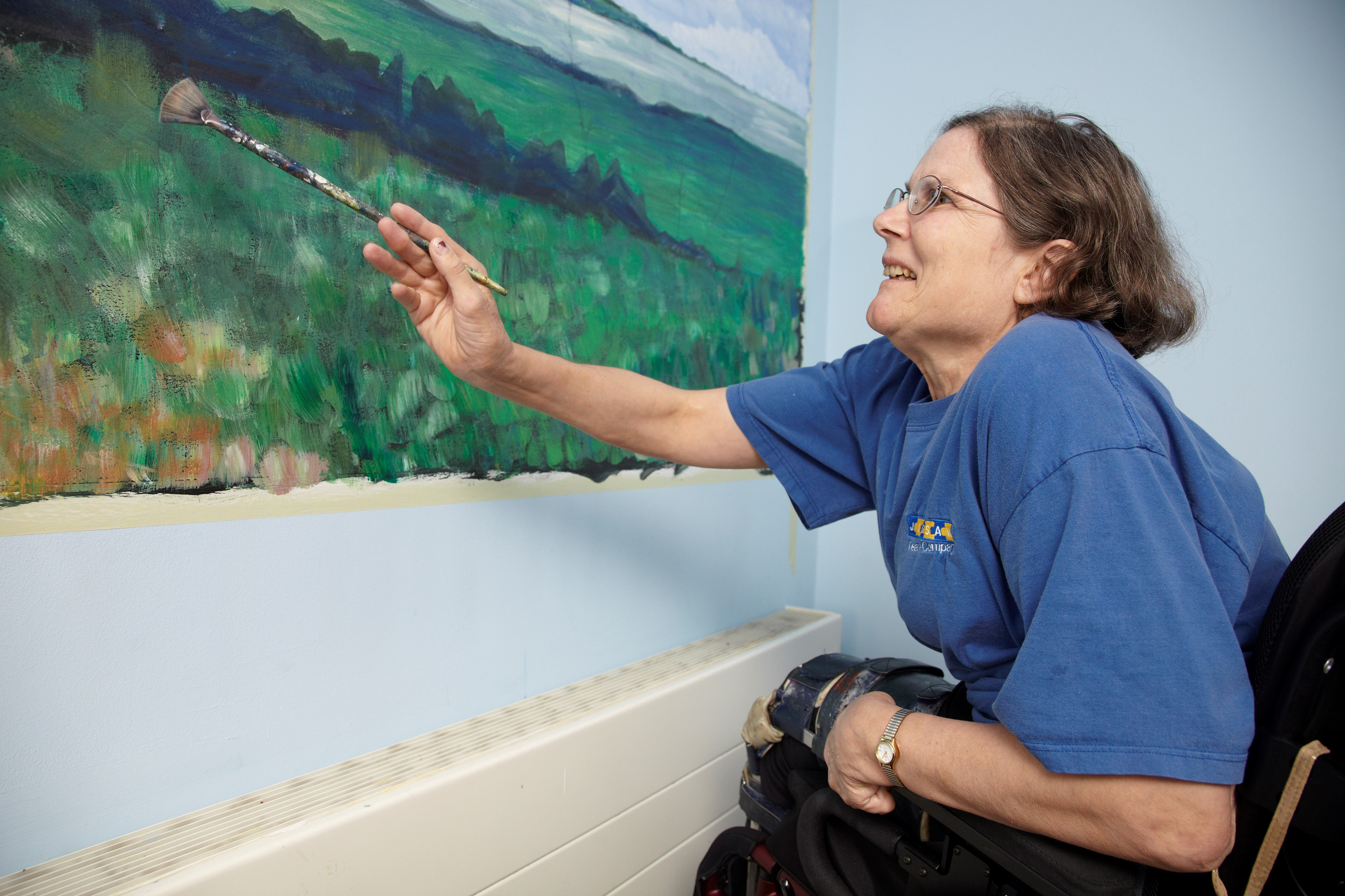 service user painting in her room at Kent House