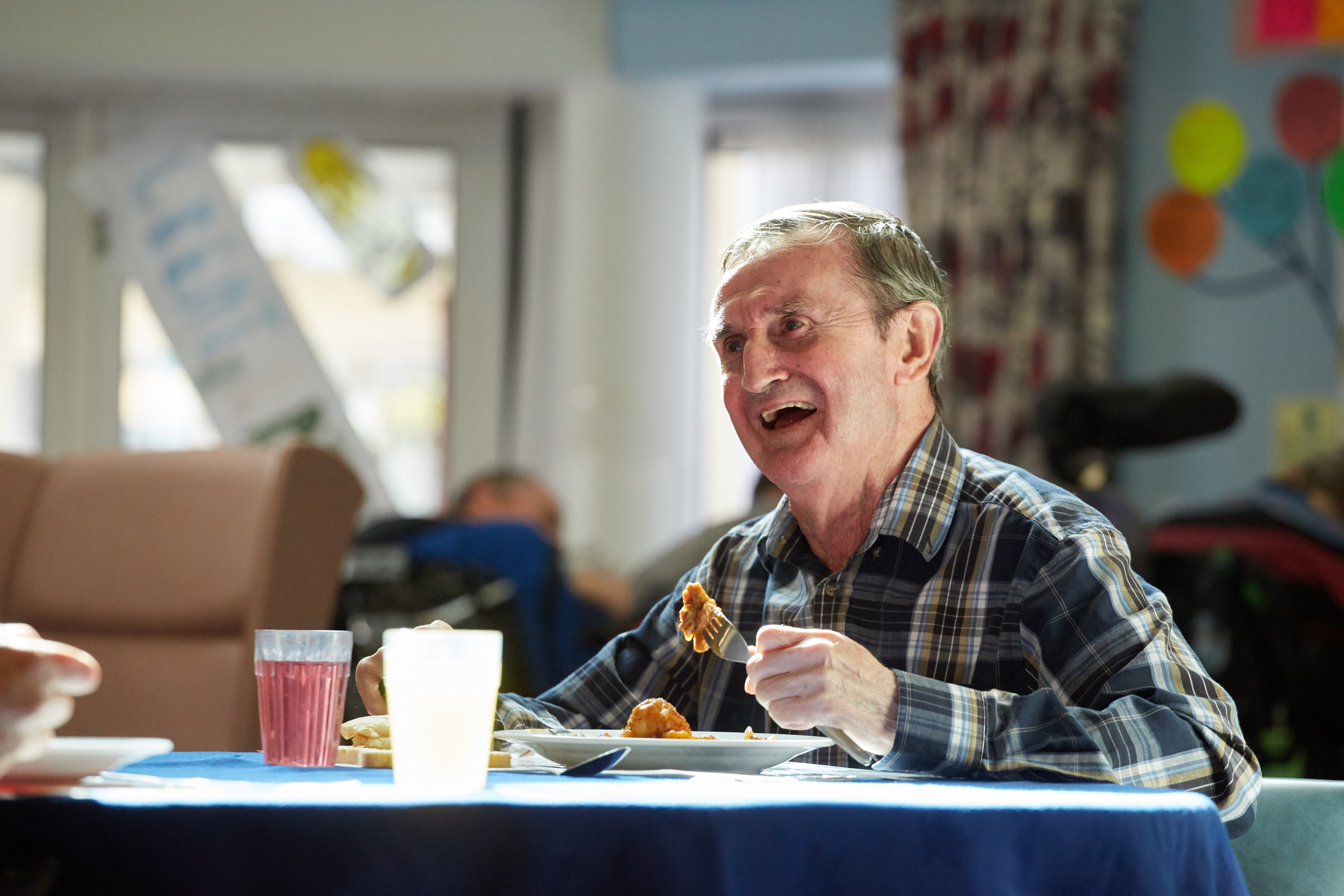 service user in the dining area in Kent House