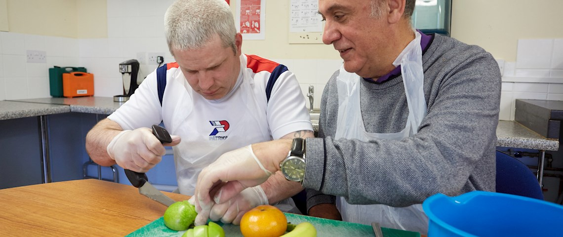 support worker and service user in the kitchens at Kent House