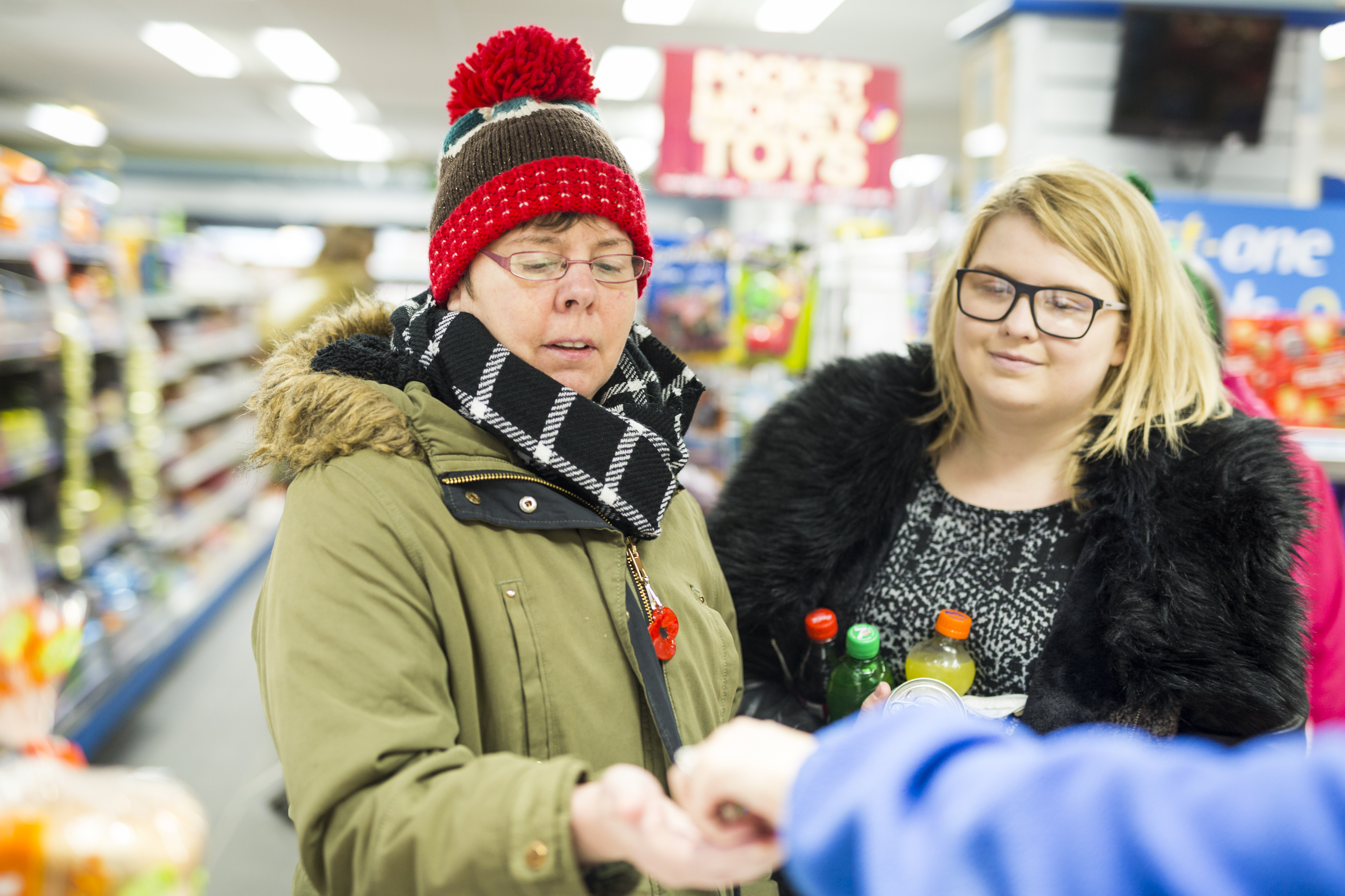 service user and support worker from Osman House shopping in the community