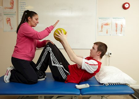service user in physical therapy session with support worker in TEM House