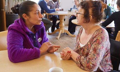 support worker and service user in the dining area of TEM House