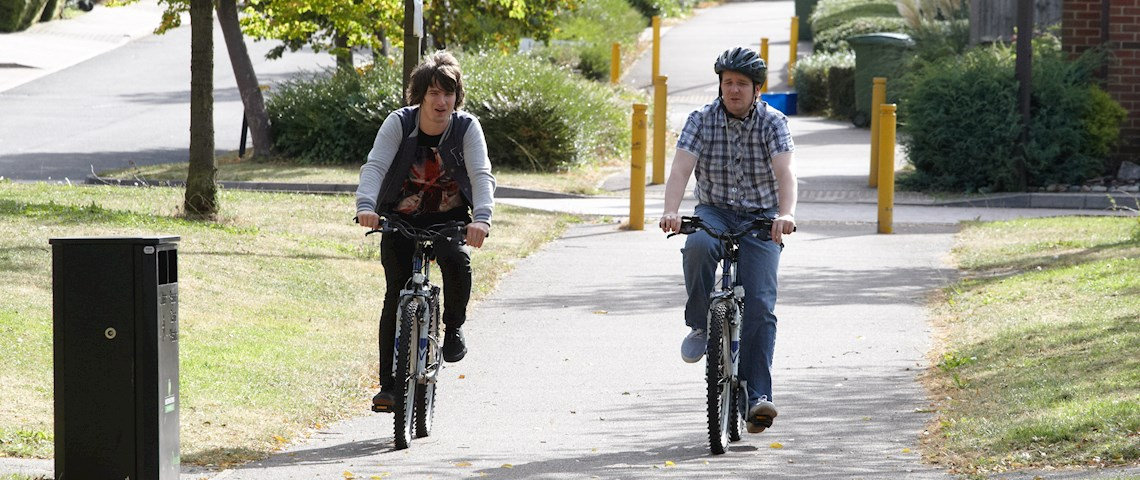 two autistic male service users riding bikes