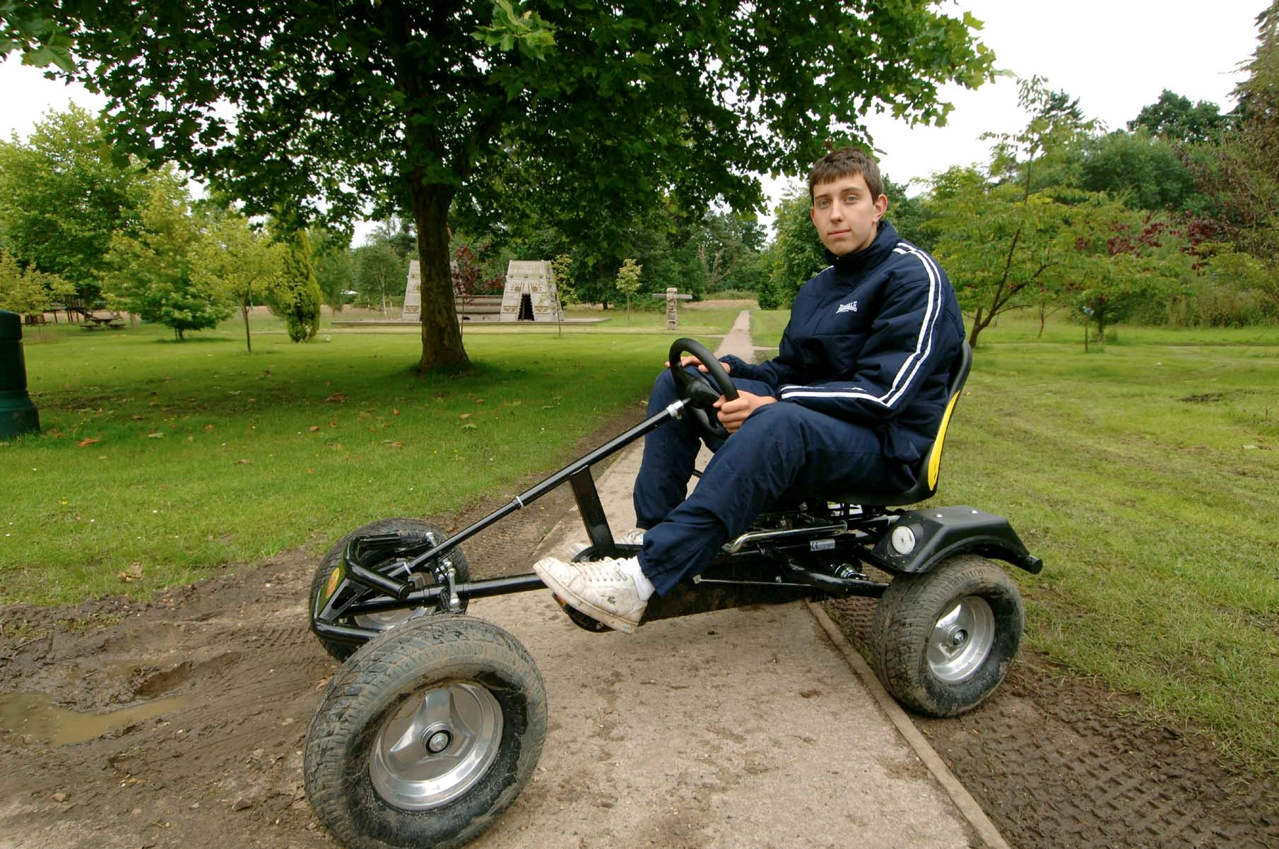autistic pupil sitting in a go-kart in the grounds of Heathermount