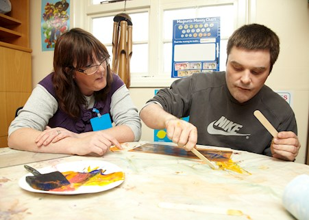 autistic service user in arts and crafts session with support worker in The Maples