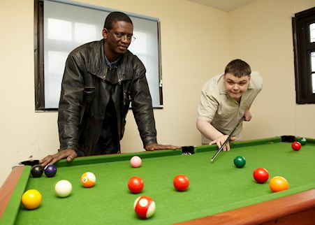 autistic service user playing a support worker at snooker in The Maples