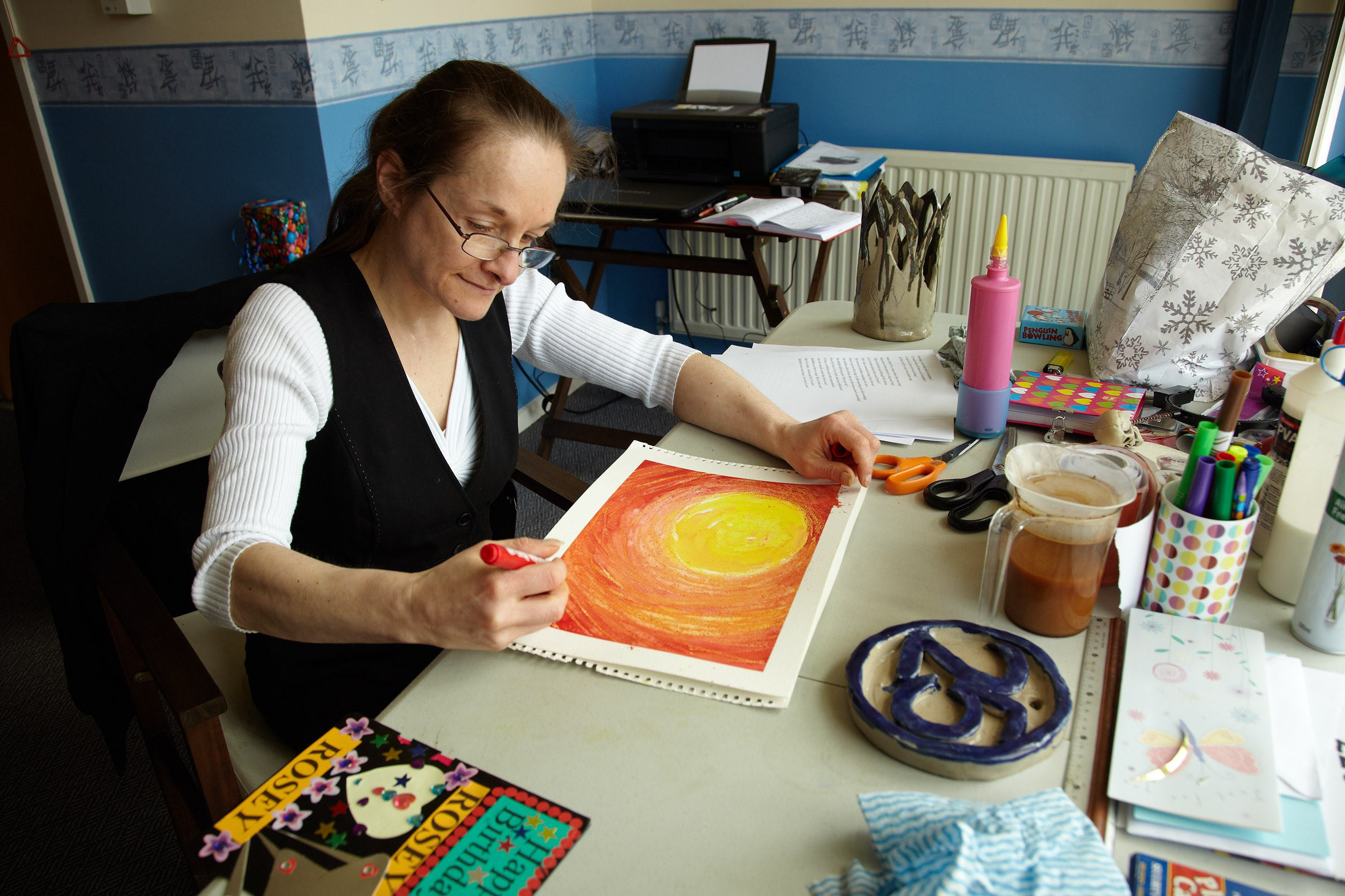 service user painting in her living quarters at Gregory Court