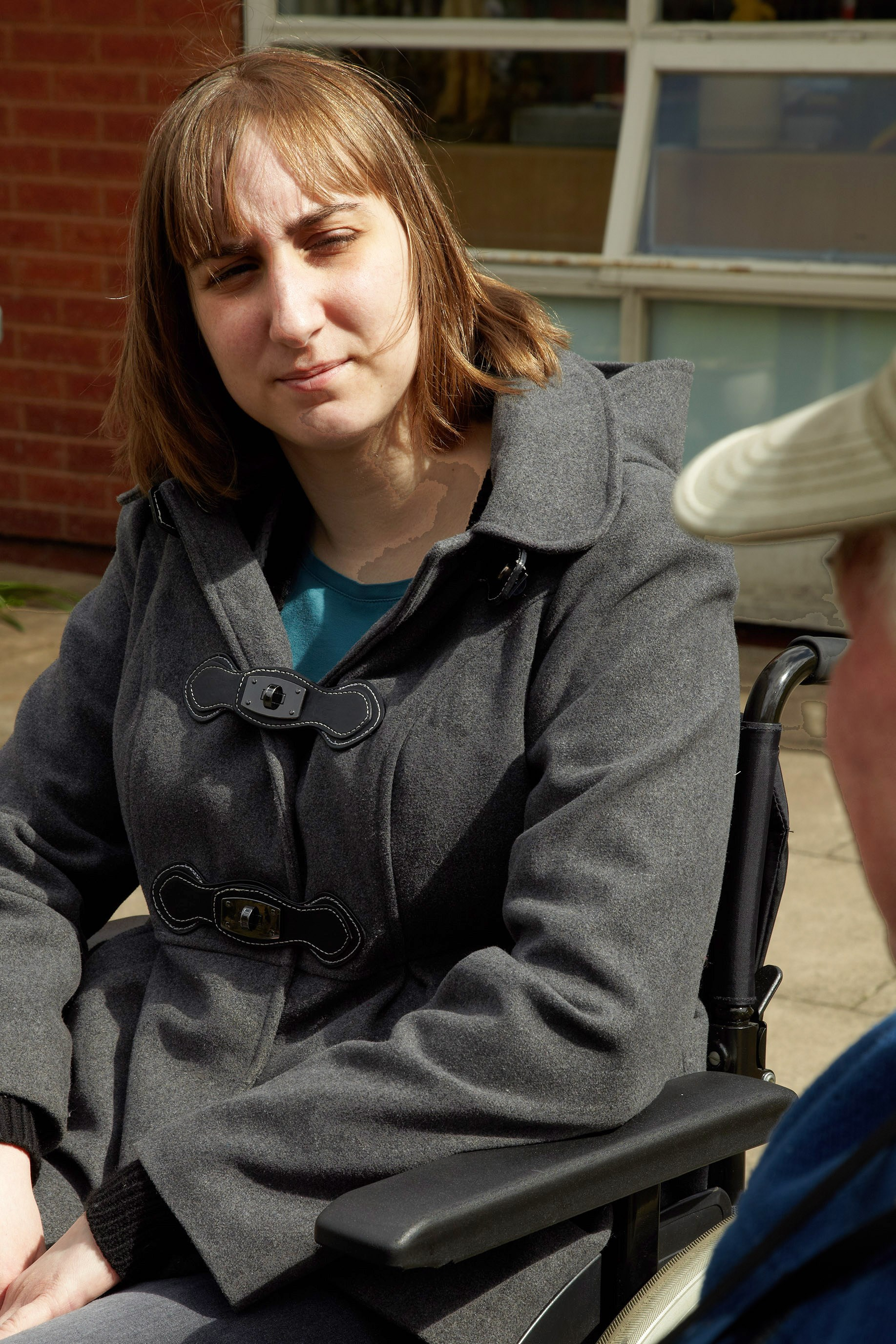 service user sitting outside Gregory Court