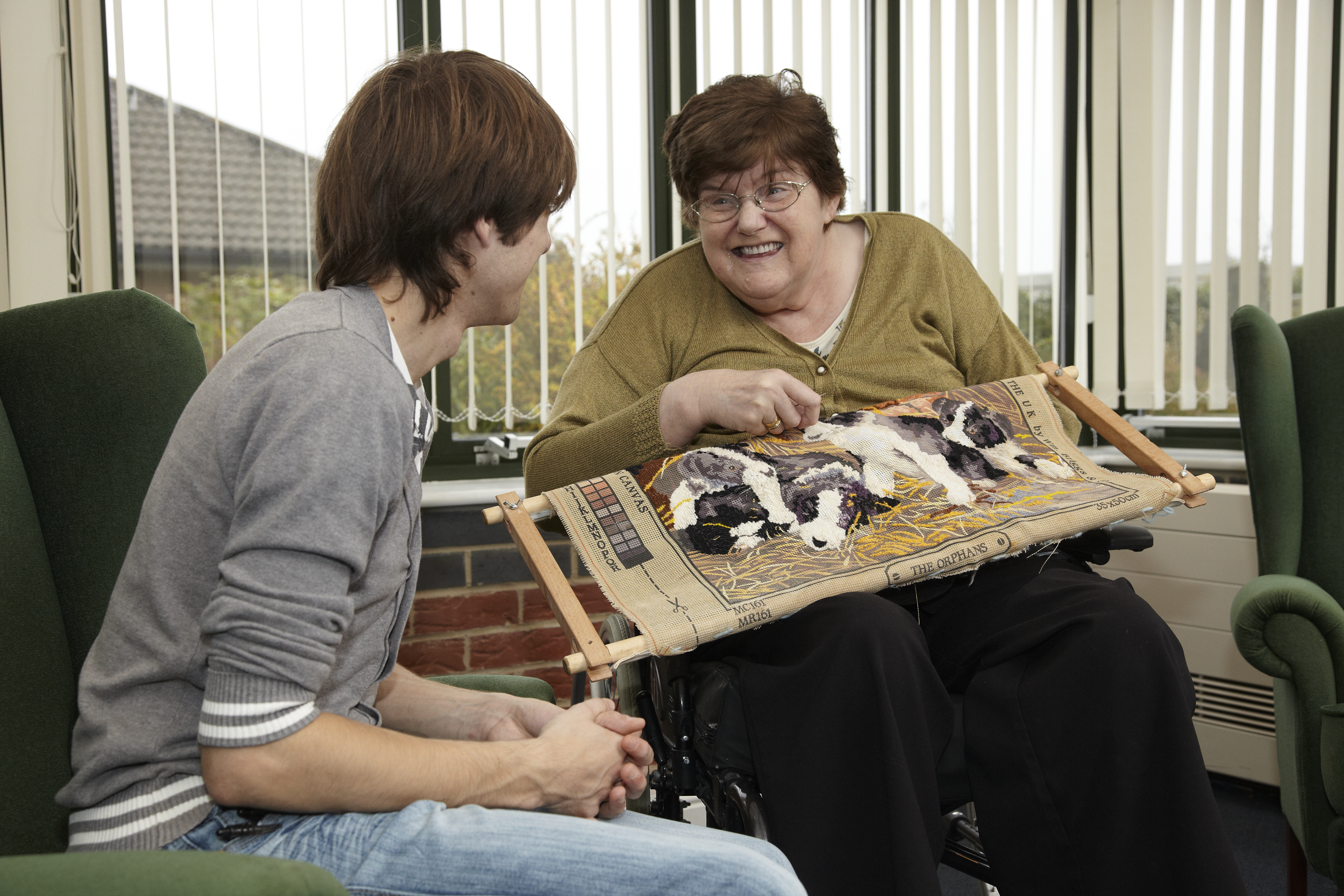 service user weaving whilst talking to a support worker at Jane Percy House