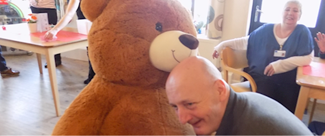 TEM House Service user playing with oversized teddy bear