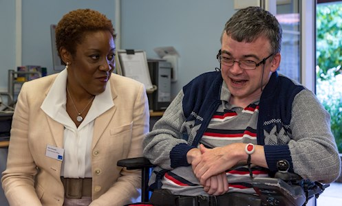 Irene Sobowale, Chief Executive of The Disabilities Trust talking to a service user at the launch of the ConnectAbility Hub, at Shinewater Court