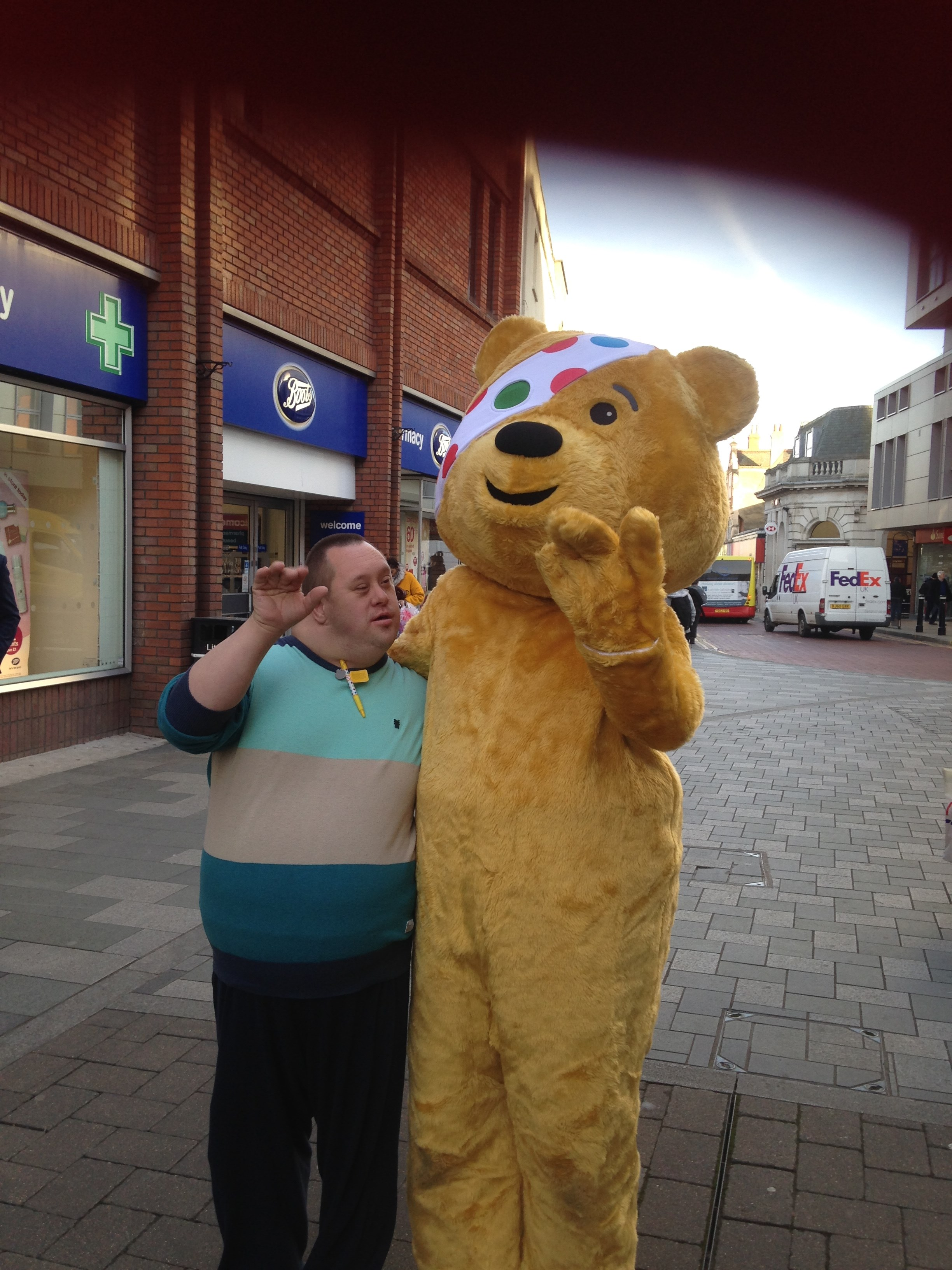 A service user from Reading posing with Pudsy bear