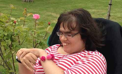 service user Hannah in the gardens at Shinewater Court